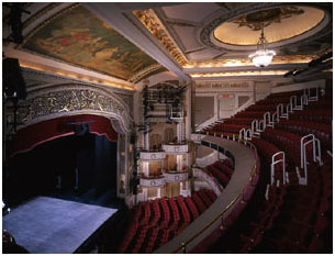 The Cort Theatre's stage arch is comprised of perforated plaster treated with art glass.