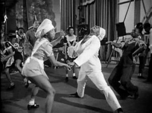 A scene from the movie version of this musical.